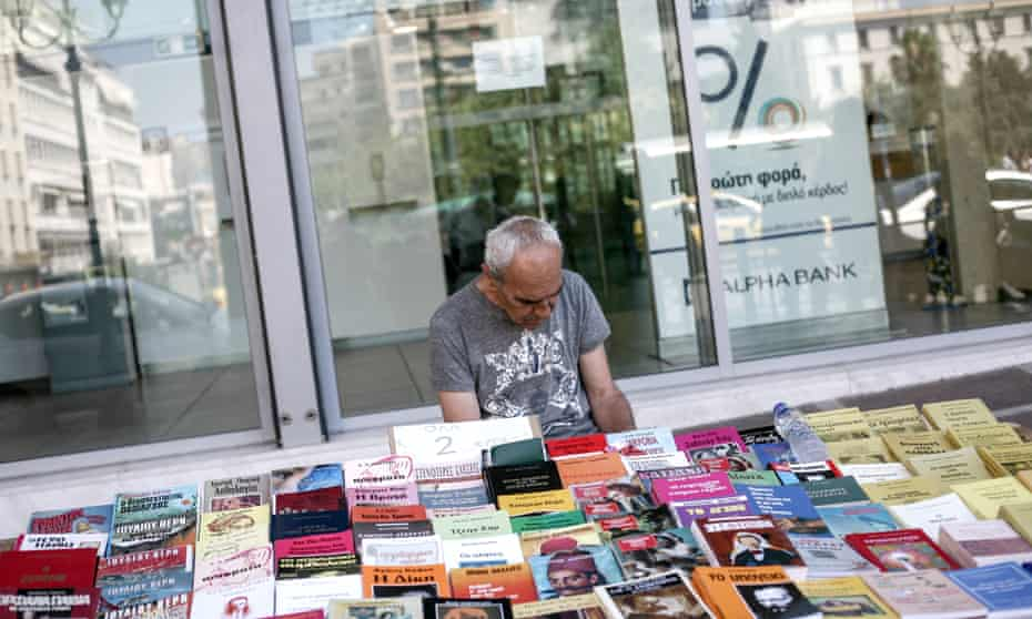 a street vendor selling books outside a bank in Athens earlier this month.