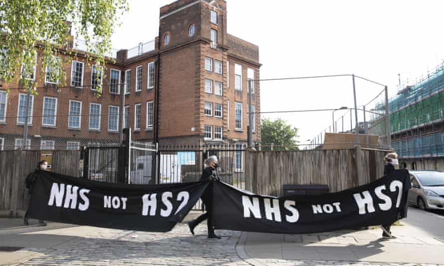 Protesters stand by a gate to the HS2 site near Euston station, central London