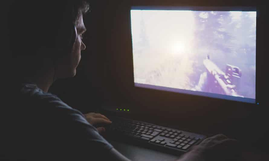 man playing a shooter video game