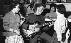 Singer and guitarist Bill Kent entertains teenage fans in The Two I's Coffee Bar, Soho, 1958.