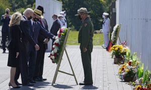 President Joe Biden, second from left, and First Lady Jill Biden, left, help place a wreath at the Wall of Names at the Flight 93 National Memorial with Gordon Felt, third from left, who lost his brother in the crash