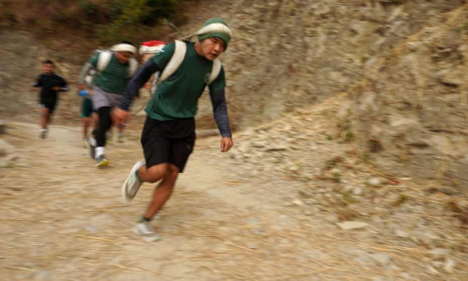 Potential recruits to the British Gurkhas reach the final stretch of the 'doko run': a5km uphill race, which they must complete in less than 46 minutes, while carrying a 2.5kg sack of sand.