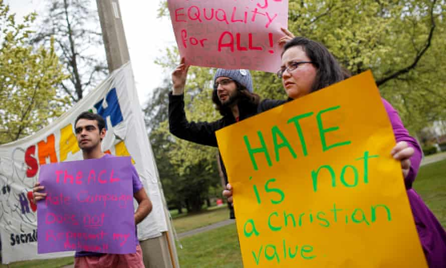 A group of protesters hold up signs during a rally for marriage equality outside the Australian Christian Lobby conference in Canberra.