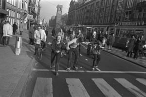 Roller skaters and cyclists on a car-free street