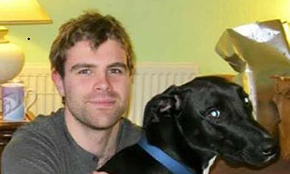 Cameron Logan, 23, with his dog Gomez, who were killed in a deliberate house fire in Milngavie, East Dunbartonshire.