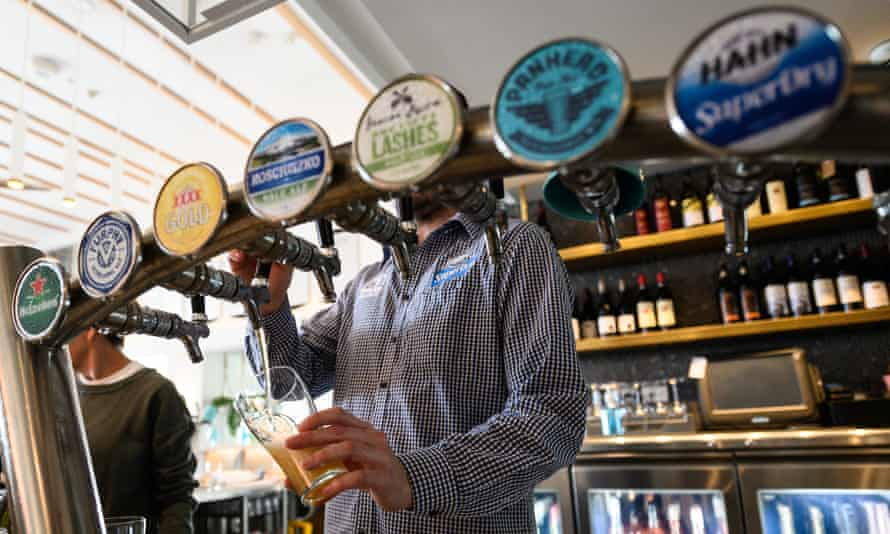 A bartender pours a beer in a bar in Sydney, Australia
