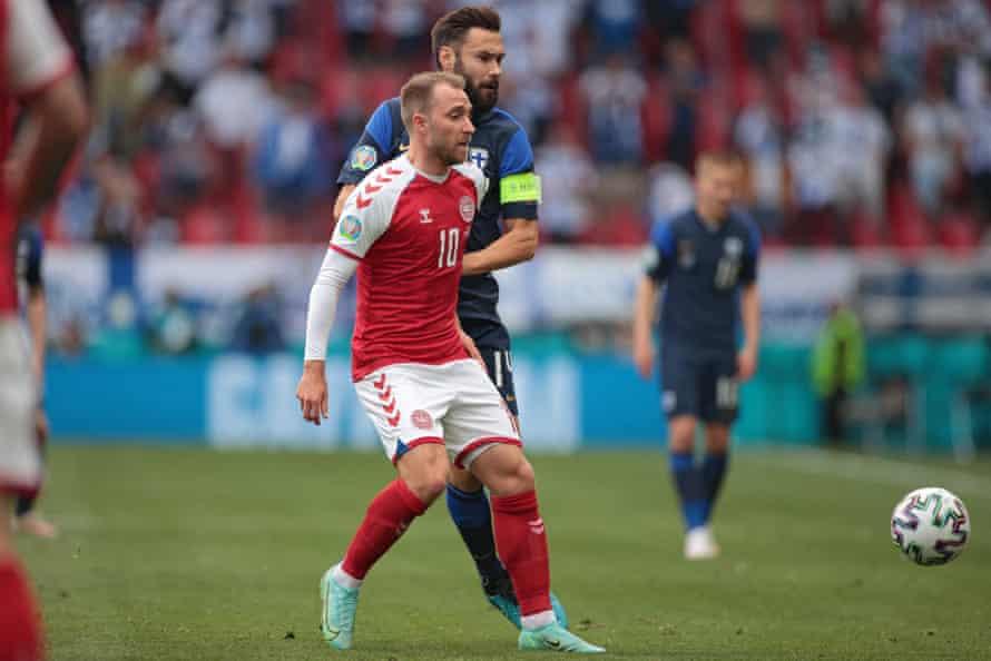 Christian Eriksen (left) vies with the Finland midfielder Tim Sparv at the Parken Stadium. Later Eriksen collapsed.