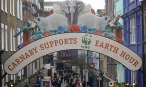 Carnaby Street's famous arch has a wildlife-themed makeover to mark Earth Hour in London.
