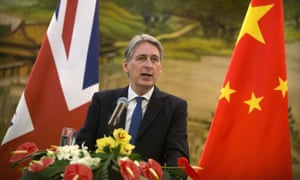 Philip Hammond speaking at a press conference in Beijing