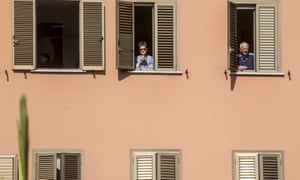 People celebrate Palm Sunday mass at their windows during  lockdown in Rome