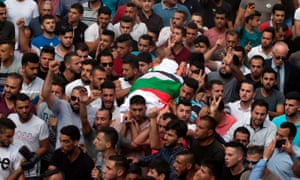 Palestinians carry the body of Aisha Rabi during her funeral in the West Bank village of Biddya