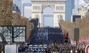 The funeral cortege makes its way down the Champs Élysées
