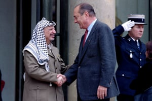 Yasser Arafat is greeted by Chirac as he arrives at the Elysée Palace in September 1995