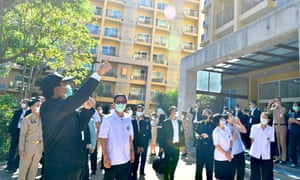 Thai Prime Minister Prayut Chan-o-cha (L) gestures as he talks to public health officials in Chonburi province, Thailand, 30 December 2020.