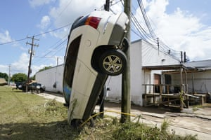 A car leans against a utility pole in Waverly.