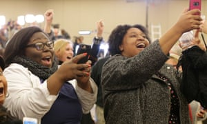 Doug Jones supporters celebrate at his election party.