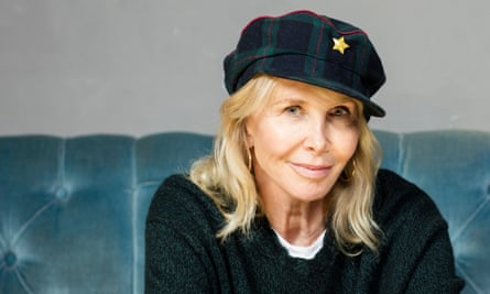 Trudie Styler, smiling, in a cap