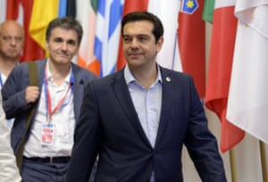 Greek Prime Minister Alexis Tsipras (R) and Finance Minister Euclide Tsakalotos leave at the end of an Eurozone Summit over the Greek debt crisis in Brussels on July 13, 2015. Juncker said there was no longer any risk of Greece crashing out of the euro after Athens agreed a bailout deal with eurozone partners. AFP PHOTO / THIERRY CHARLIERTHIERRY CHARLIER/AFP/Getty Images