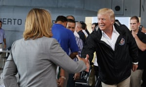 Donald Trump shakes hands with San Juan's mayor, Carmen Yulín Cruz. After he criticized Cruz on Twitter, Russian-linked Twitter accounts disseminated articles focused on discrediting her, analysts say.