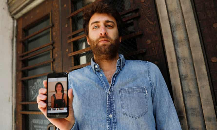 Matthew Caruana Galizia holds a picture of his mother, Daphne Caruana Galizia, who was killed in a car bombing in 2017.
