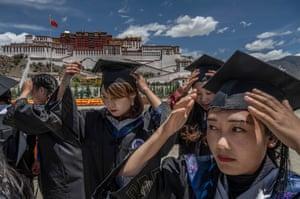 Tibetan University graduates prepare to have their photos taken in front of the Potala Palace
