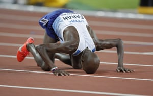 Farah falls to his knees after winning the 10,000m.