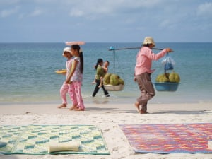 Food sellers walk the beach at Sihanoukville, CambodiaPhotograph Tim Thorpe/GuardianWitness