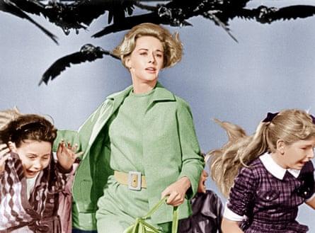 Sharp suited … Tippi Hedren (centre) in The Birds (1963).