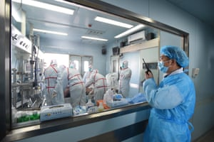 Medical staff treat a bird flu patient at the Wuhan Medical Treatment Centre in China