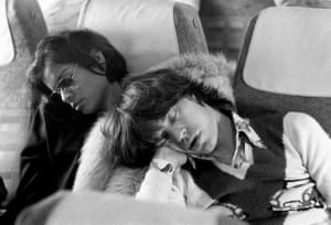 Mick and Bianca Jagger asleep on the plane home after celebrating the last night of the Rolling Stones 1973 European tour in Berlin