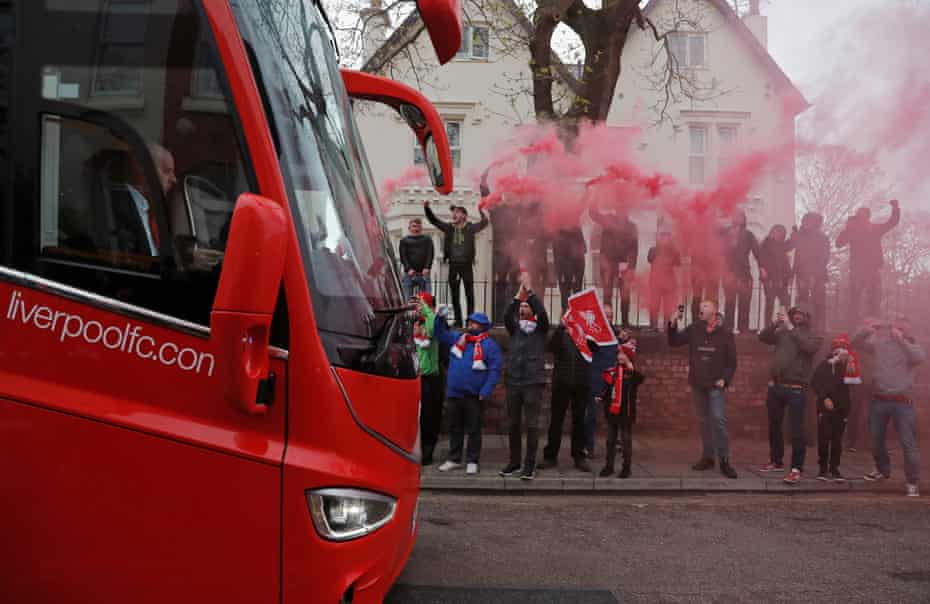 Fans welcome the Liverpool team coach before the Liverpool v Huddersfield Premier League match at Anfield in April 2019.