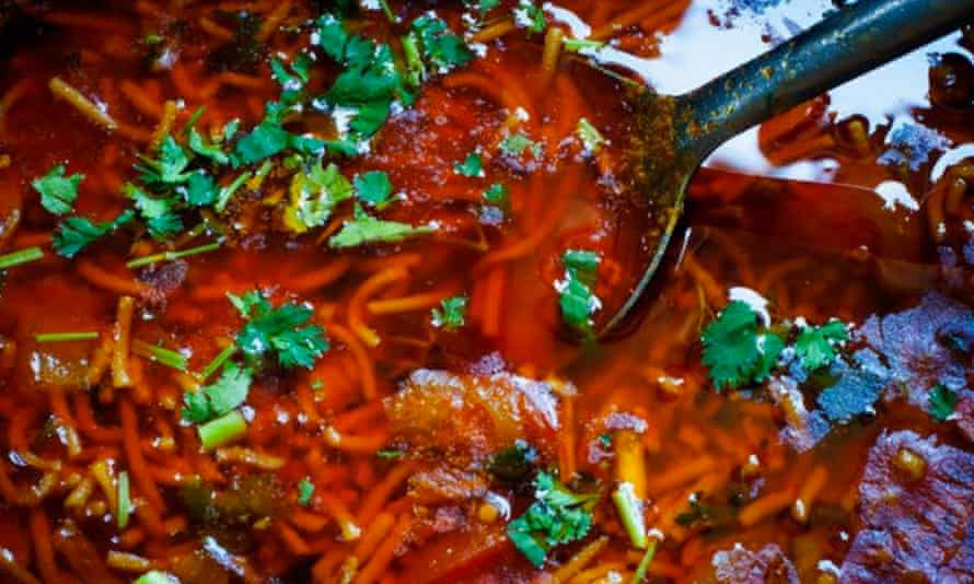 Close up of dish of laal mass being cooked.