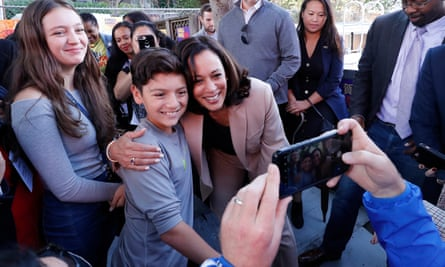 Harris poses for photos with supporters during the opening of her office in Oakland, California, in September 2019.