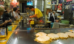 Okonomimura. Okonomiyaki (Japanese Pancake) being made at a fast food outlet.