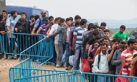 Refugees wait to make their way to Macedonia after being let through by Greek Police.