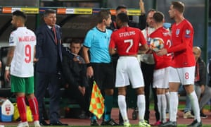 Jordan Henderson, right, and England teammates speak to members of Bulgaria's staff, including the manager Krasimir Balakov, second left.