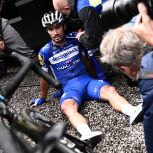 Alaphilippe looks dejected after crossing the finish line of the penultimate stage. The Frenchman had led the race for 14 days. However, he lost the yellow jersey to Bernal on the storm-shortened 19th stage and again fell away on the race's final major climb and will finish fifth overall.