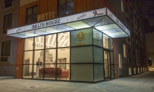 Exterior of BKLYN House Hotel, New York, at night, with its ground floor reception area illuminated.