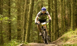 Mountain biker on the 7 Stanes forest trail in Dumfries.