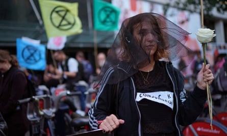 An Extinction Rebellion protester on The Strand in London.