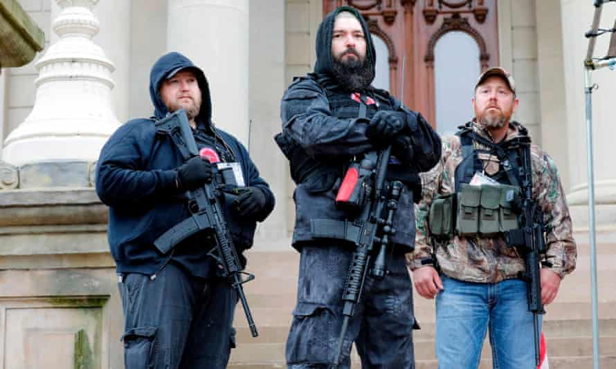 Michael Null, left, one of the men charged for the plot to kidnap governor Gretchen Whitmer, takes part in an anti-lockdown rally at the Michigan state capitol in April.