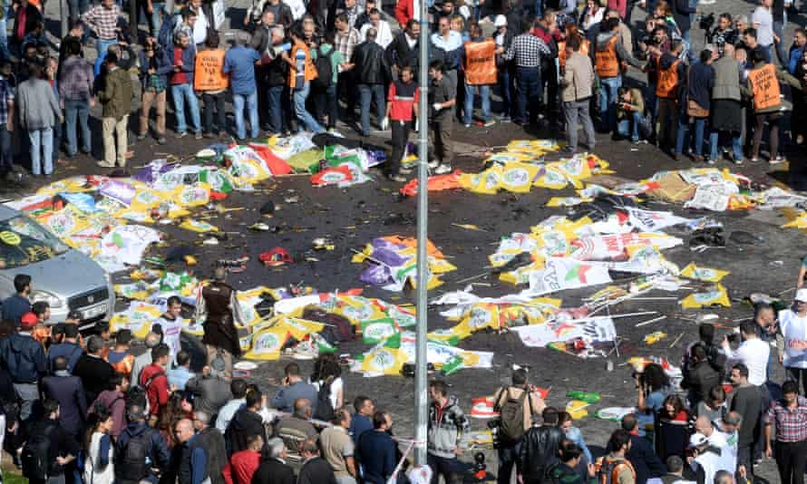 Victims lie on the street in Ankara as the scene of the explosion is cordoned off .