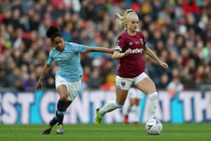 West Ham United's Alisha Lehmann takes on Demi Stokes of Manchester City during the FA Cup Final at Wembley.