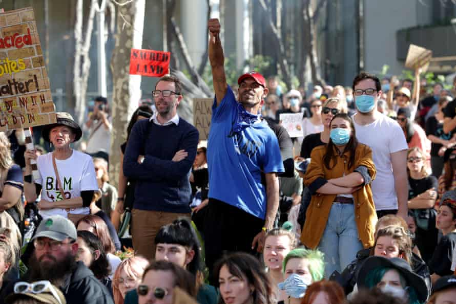 Protesters gather outside the Rio Tinto office in Perth on Tuesday.
