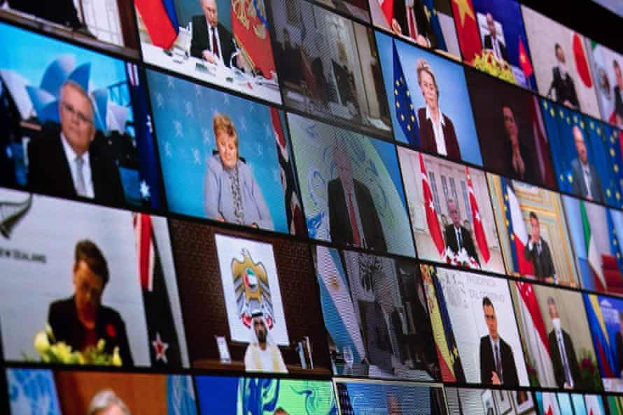 World leaders are seen on a screen at the White House during the virtual climate summit on 22 April.