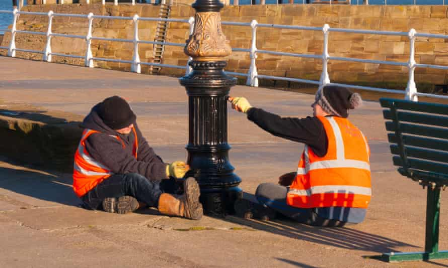 Two offenders on the Community Payback scheme, administered by the Probation Service, painting a lamppost on Whitby Pier.