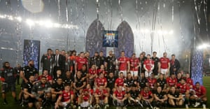 The All Blacks and the British & Irish Lions line up for a group photograph at the end of the game and series.