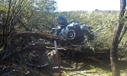 The woman's car plunged down a ravine and landed in a tree, near Wickenburg Arizona.