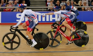 Mark Cavendish and Bradley Wiggins handsling as they break away and go on to win the Madison at the World Track Cycling Championships.