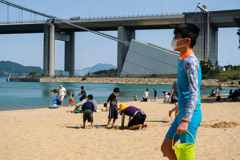 Beachgoers in Hong Kong make the most of the good weather.